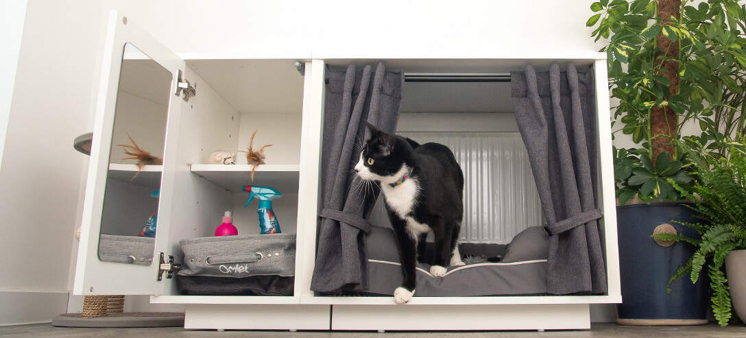 The Maya Nook indoor cat house is available in two sizes and features an optional storage wardrobe and curtains that can be used to create an enclosed sanctuary of calm