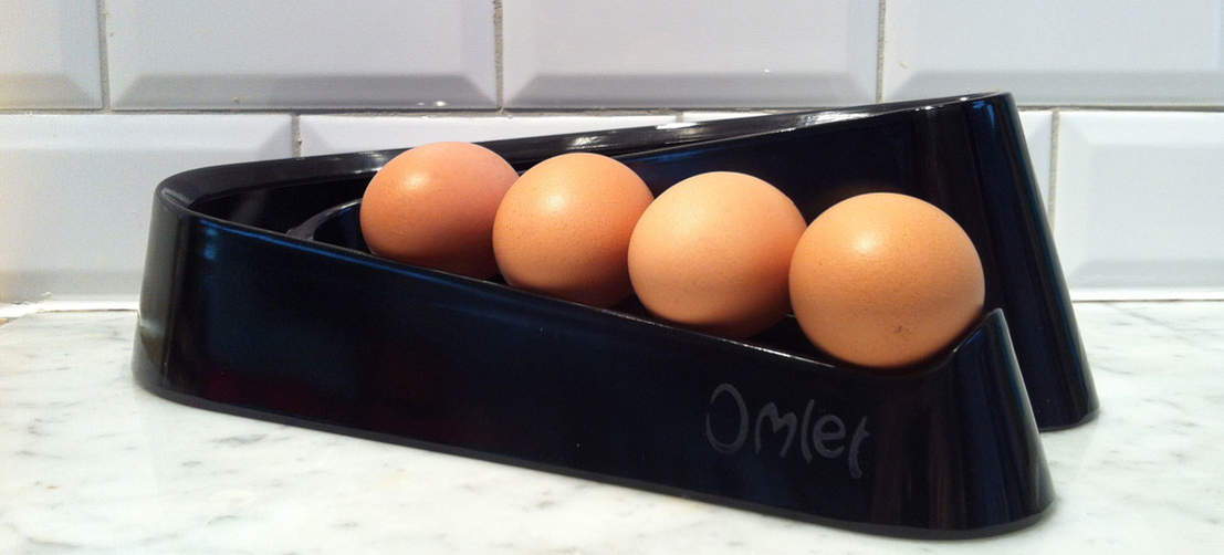 A black Egg Ramp on marble worktop