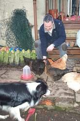 Andy feeding Hens