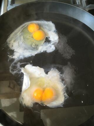 Poached eggs - both have double yolks!