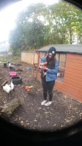 holding the chickens in college.