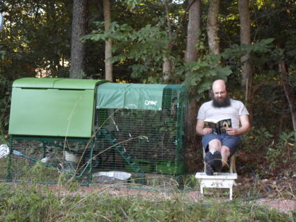 "Son Curtis relaxing by the chickens.  I call him ""the chicken whisperer""!! : )"