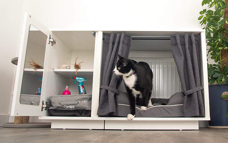 The Maya Nook indoor cat house is available in two sizes and features an optional storage closet and drapes that can be used to create an enclosed sanctuary of calm