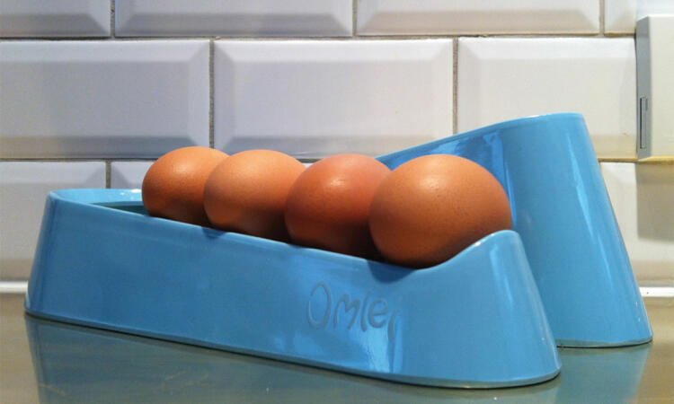 Blue Egg Ramp on a gold worktop