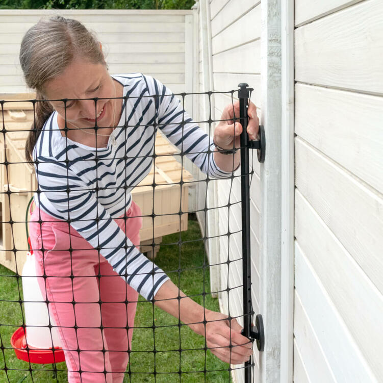 The new Wall Connection Kit coming winter 2021, makes attaching the Omlet chicken fencing to an existing fence super easy!