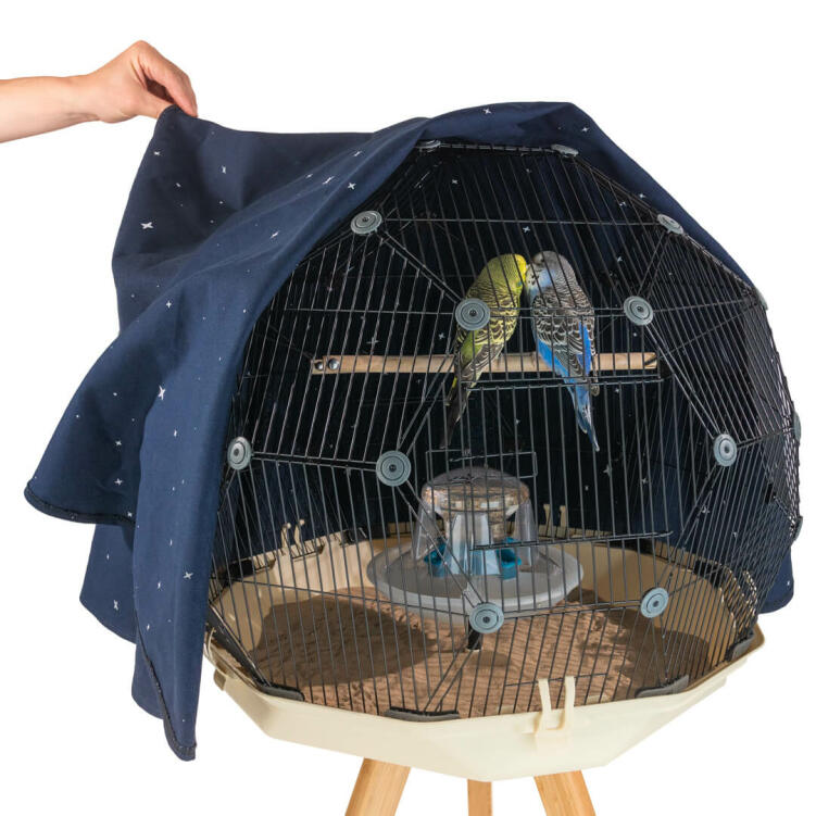 The Constellation Geo Bird Cage Cover is decorated on the inside with a map of the stars so your parakeets can enjoy the wonder of the night sky from the tranquility of their perch