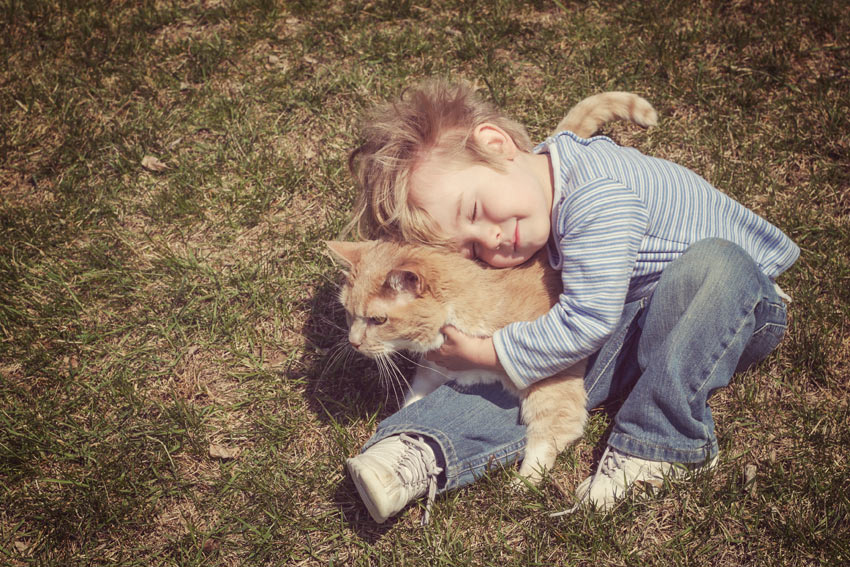 A young boy cuddling his new furry friend