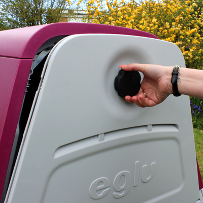Opening the back door of an Eglu Go Hutch.