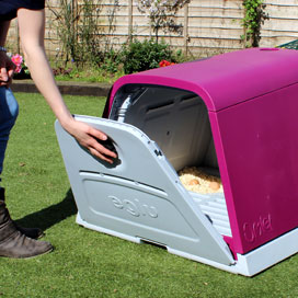 The Eglu Go has a single large door at the back, which you can open to reveal the roosting bars, nesting area and dropping tray.