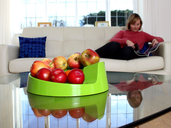 Green Rollabowl Fruit Bowl on coffee table.