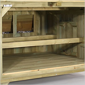 Inside of a Lenham chicken coop showing nesting box and perches.
