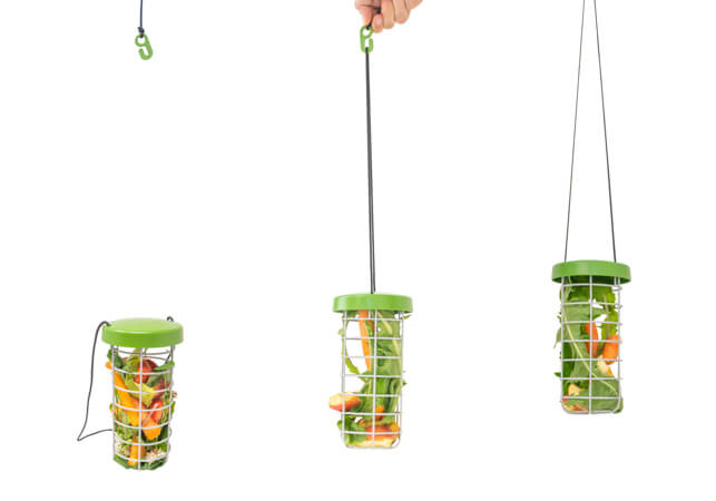 Three images of the Caddi rabbit feeder, the first of which is detached from the plastic hook, the second is being attached to the hook with the nylon string and the third Caddi is hanging from the hook