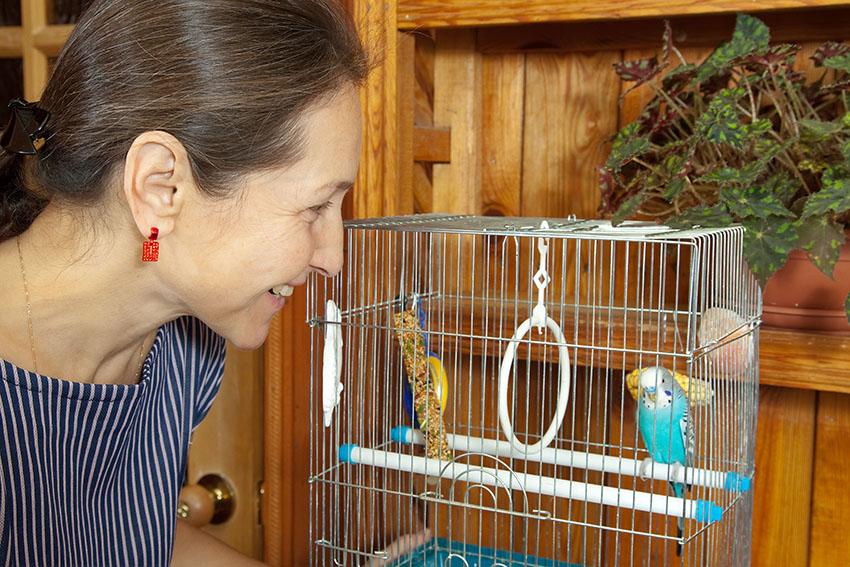woman with parakeet